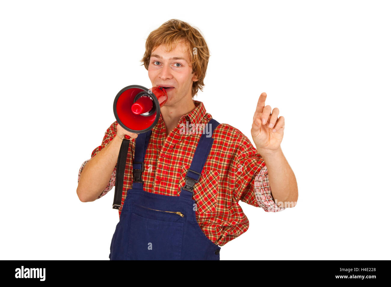 Young handcrafter with megaphone isoladet on white background Stock Photo