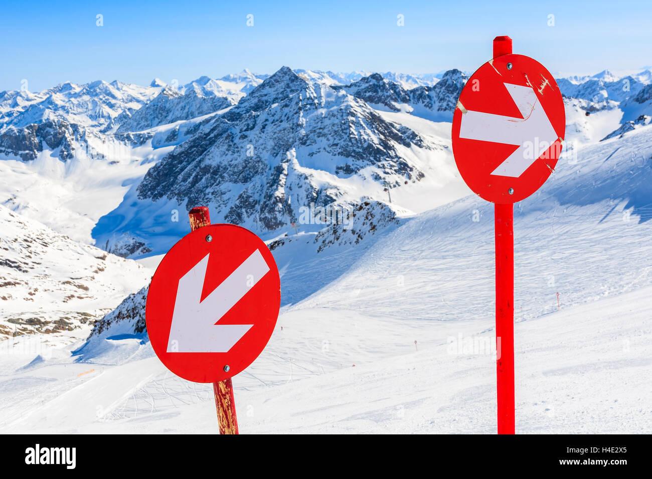 Red signs on ski slope in ski resort of Pitztal, Austrian Alps Stock Photo