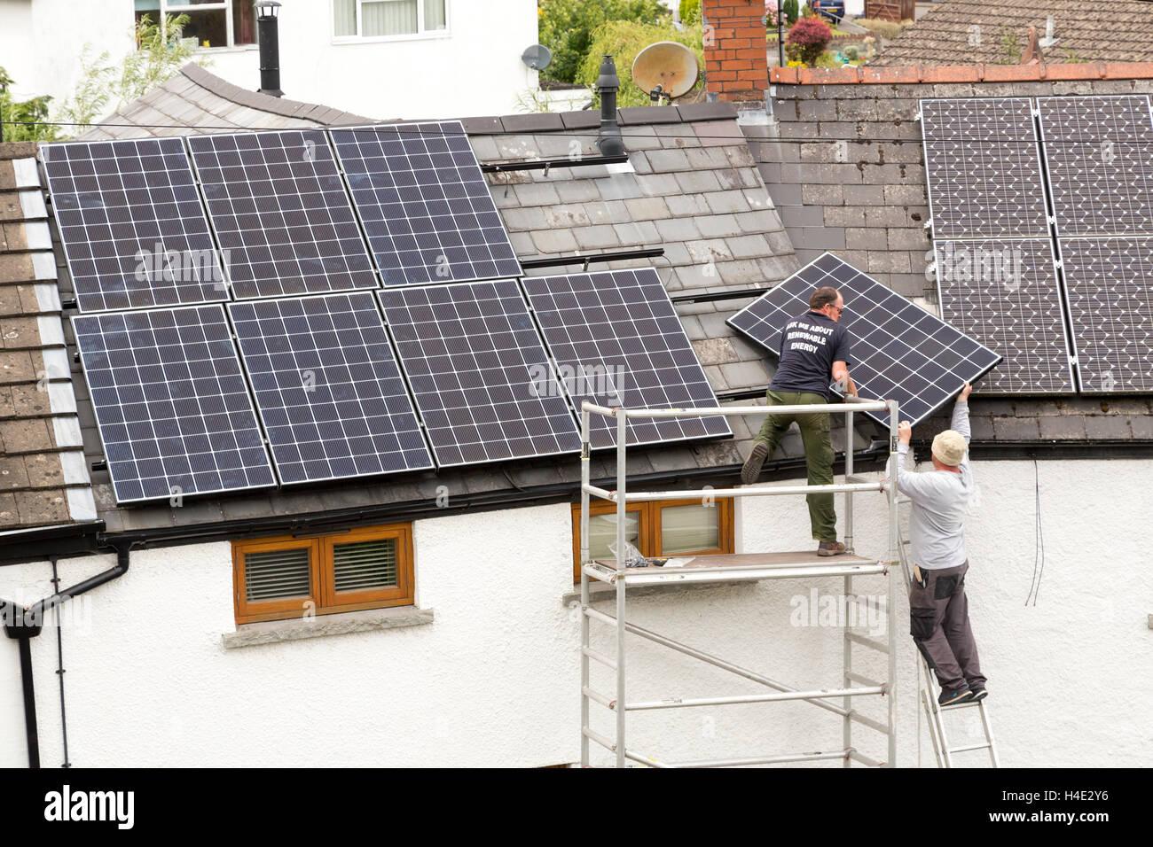 Solar panel installation on domestic roof, Llanfoist, Wales, UK - Stock Image