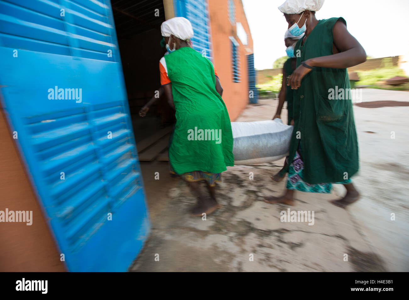Bags of shea nuts are unloaded at a warehouse for shea butter production in Réo Burkina Faso, West Africa. Stock Photo