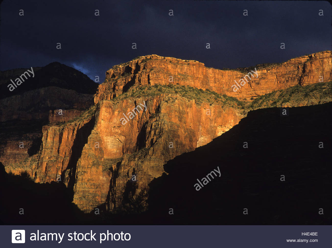 Late light shines on a cliff after a storm in Marble Canyon. - Stock Image