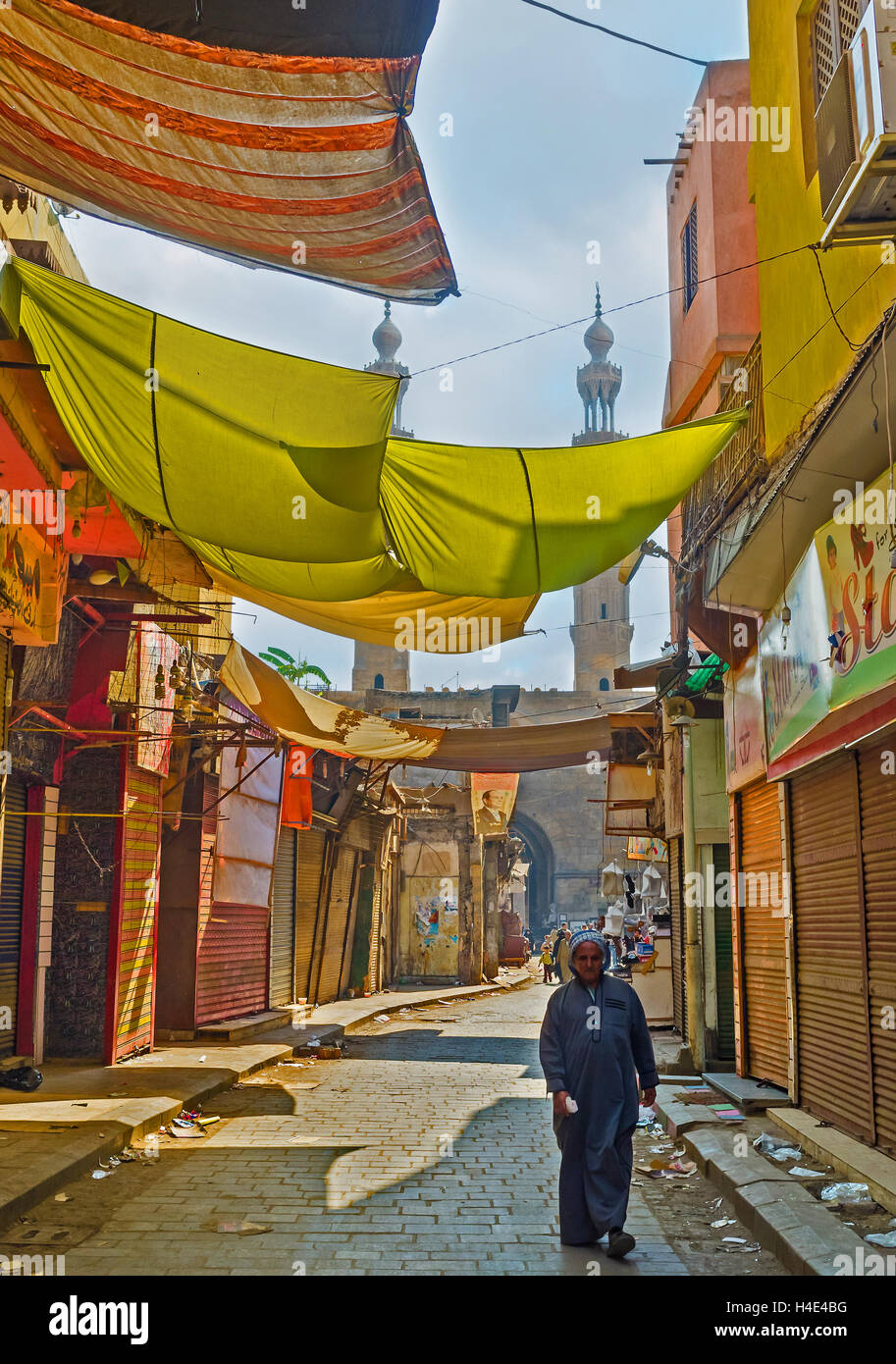 The merchants of Al-Muizz street market use colorful cloth to make the sunshades over the stalls, Cairo Egypt - Stock Image