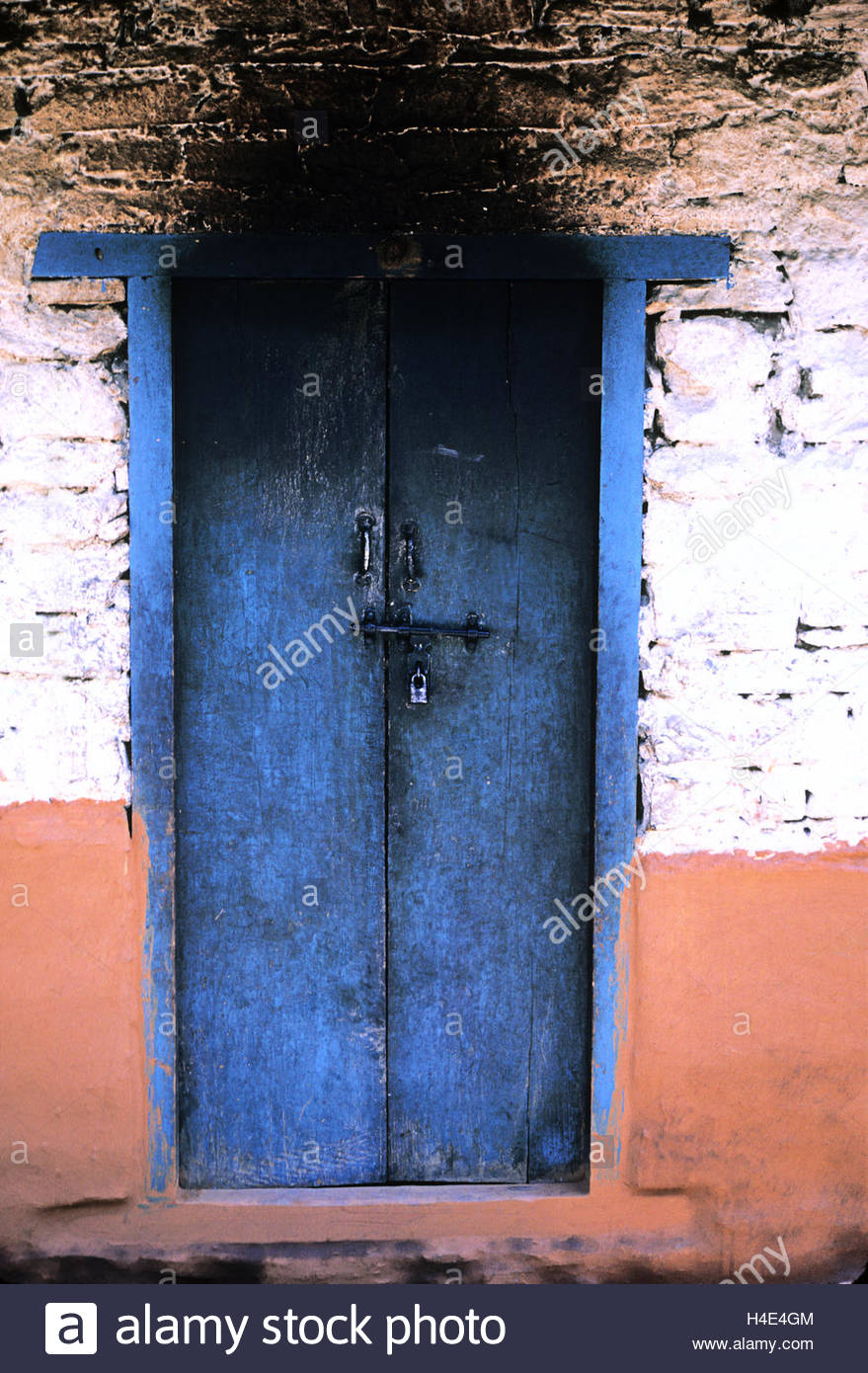 A painted doorway in Katmandu. - Stock Image