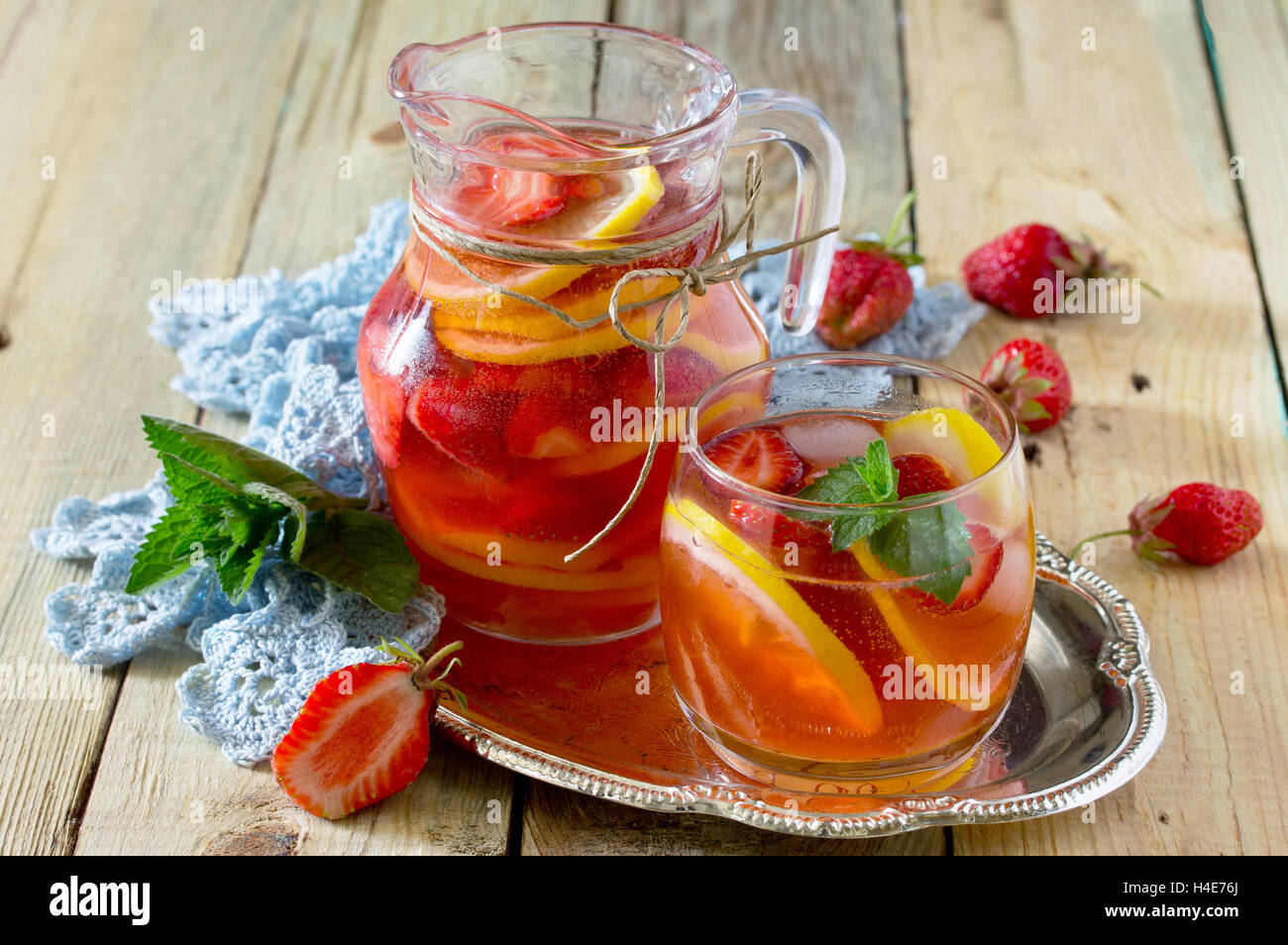 Tradition Summer mojito drink with lemon and mint with copy space in a rustic style. - Stock Image