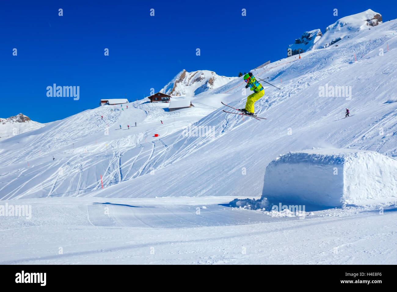 Flying skier skiing in Hoch-Ybrig mountain resort, Switzerland - Stock Image