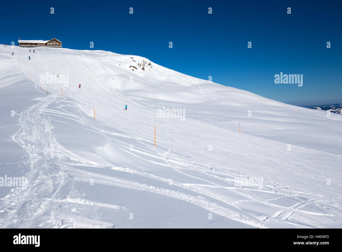Skiers skiing on ski slopes on the top of Hoch Ybrig resort, Switzerland - Stock Image