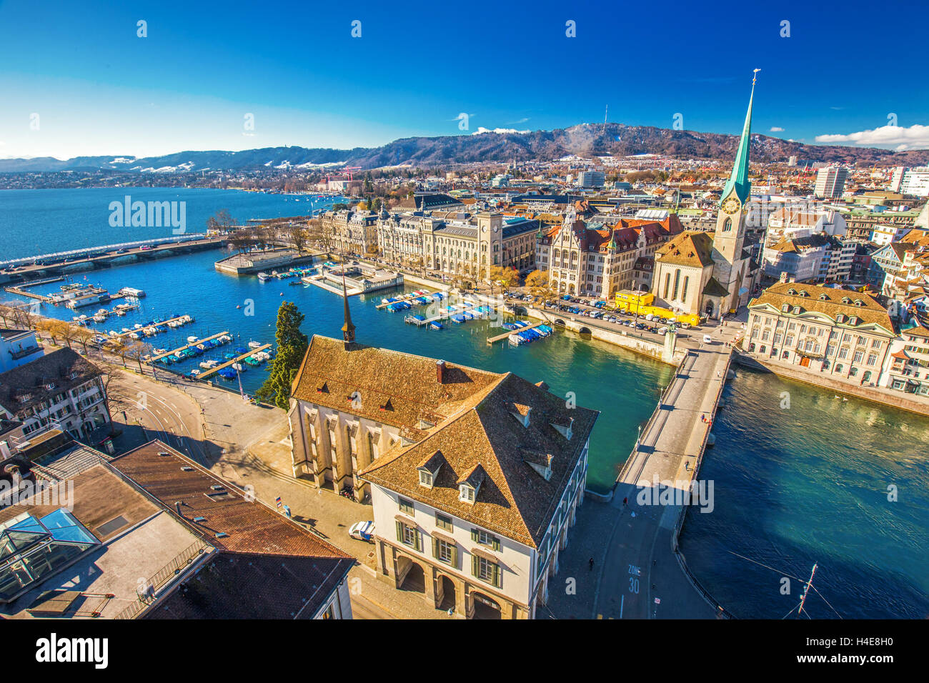 View of historic Zurich city center with famous Fraumunster Church, Limmat river and Zurich lake from Grossmunster Stock Photo