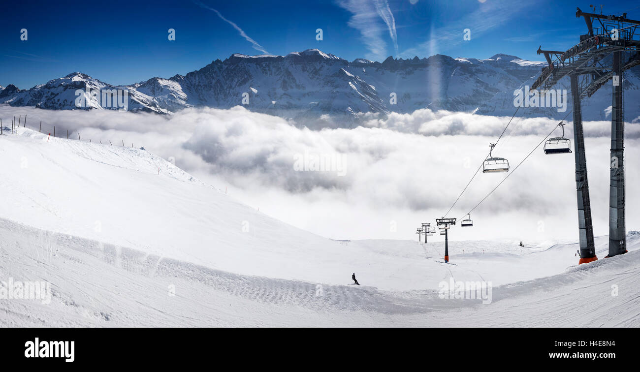 panorama view to chair lift in elm ski resort, swiss alps stock