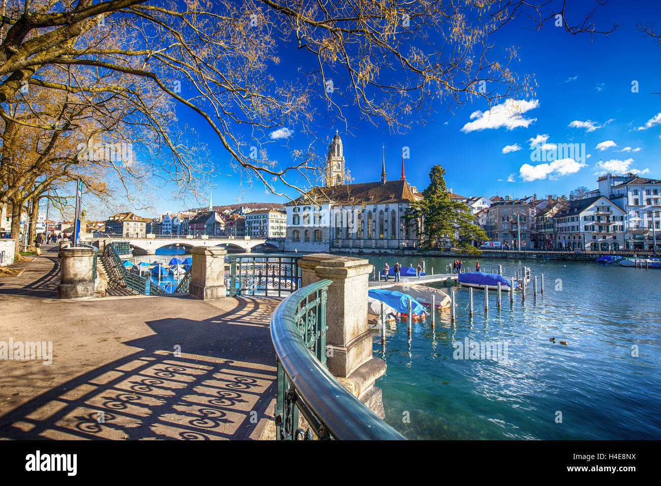 View of historic Zurich city center with famous Grossmunster Church and Limmat river - Stock Image
