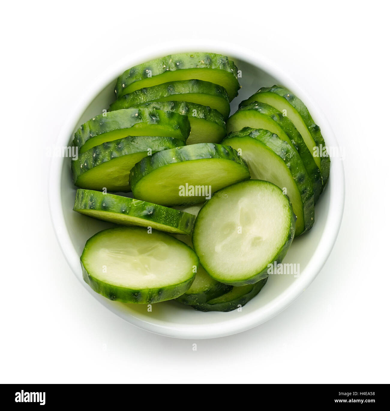 Bowl of fresh cucumber slices, top view - Stock Image