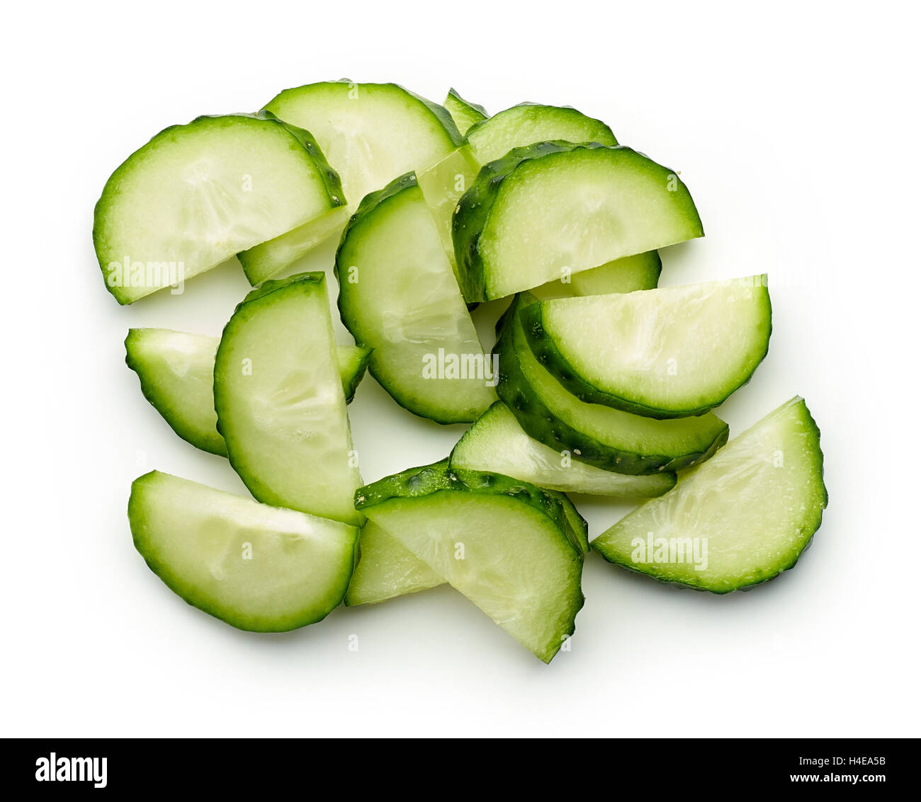 Fresh cucumber slices isolated on white background, top view - Stock Image