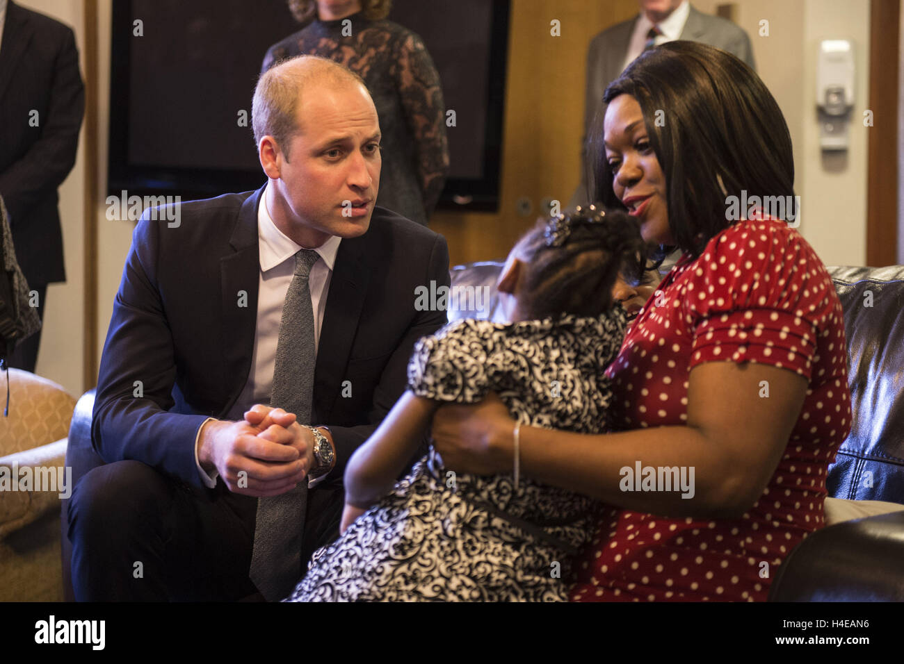 The Duke of Cambridge speak with familes receiving support, staff and trustees during a visit to Francis House hospice - Stock Image