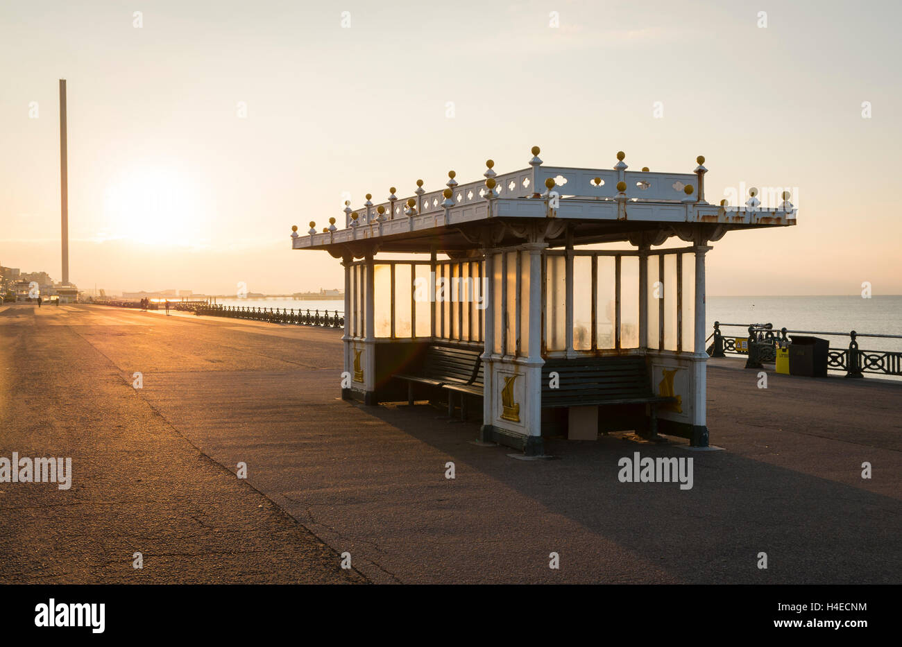 Ornate regency seating shelter with benches in on Brighton / Hove seafront promenade with sunrise in the background Stock Photo