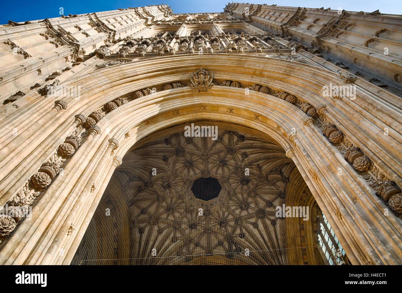 Looking upwards at the Victoria Tower and Sovereign's Entrance at the Palace of Westminster, London UK - Stock Image