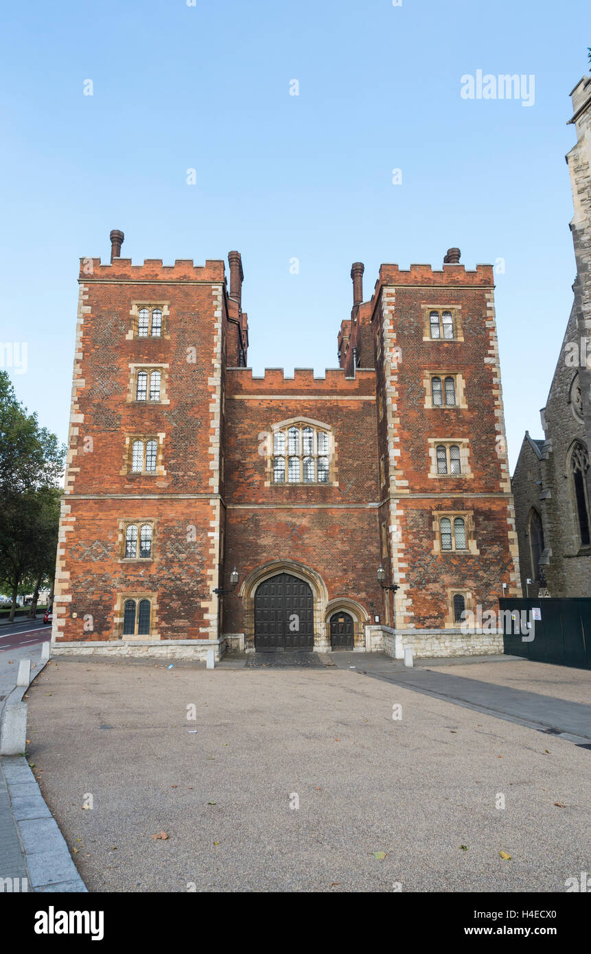 Morton's Tower is a tudor red brick gatehouse at Lambeth Palace, London, pictured on a sunny day with blue sky - Stock Image