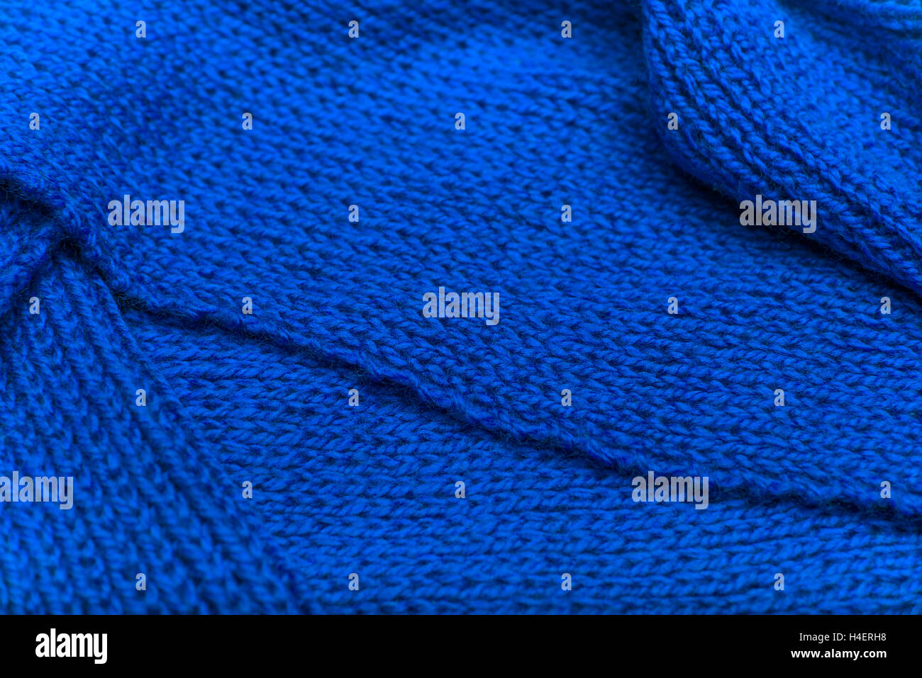 The texture of the knitted fabric. Place for placing of your text. - Stock Image