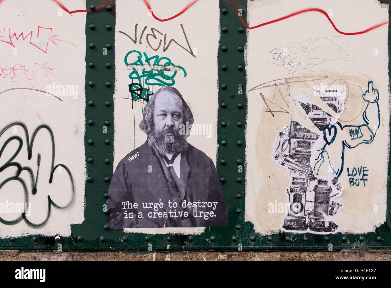 Sticker on a wall representing Mikhail Bakunin and the quote 'The urge to destroy is a creative urge' printed - Stock Image