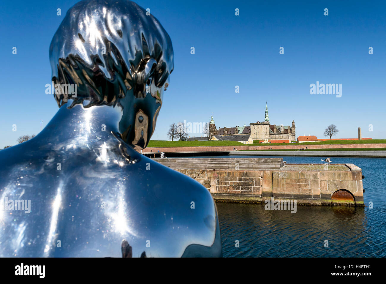 Sculpture of 'Han' (He) as looking at Kronborg Castle, residence of Hamlet, settled in a town Helsingor, - Stock Image