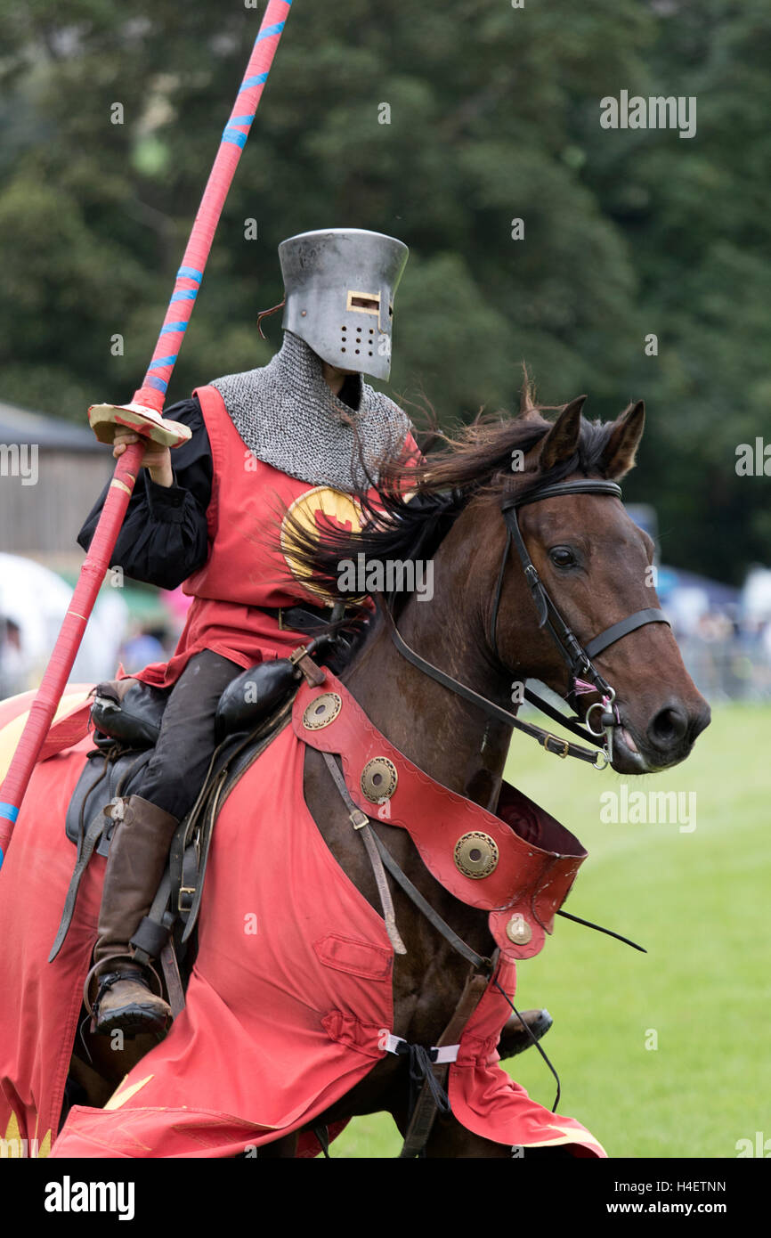 A Knight entering the field during a jousting  re-enactment event at the Stanhope Show, Co. Durham, England. - Stock Image