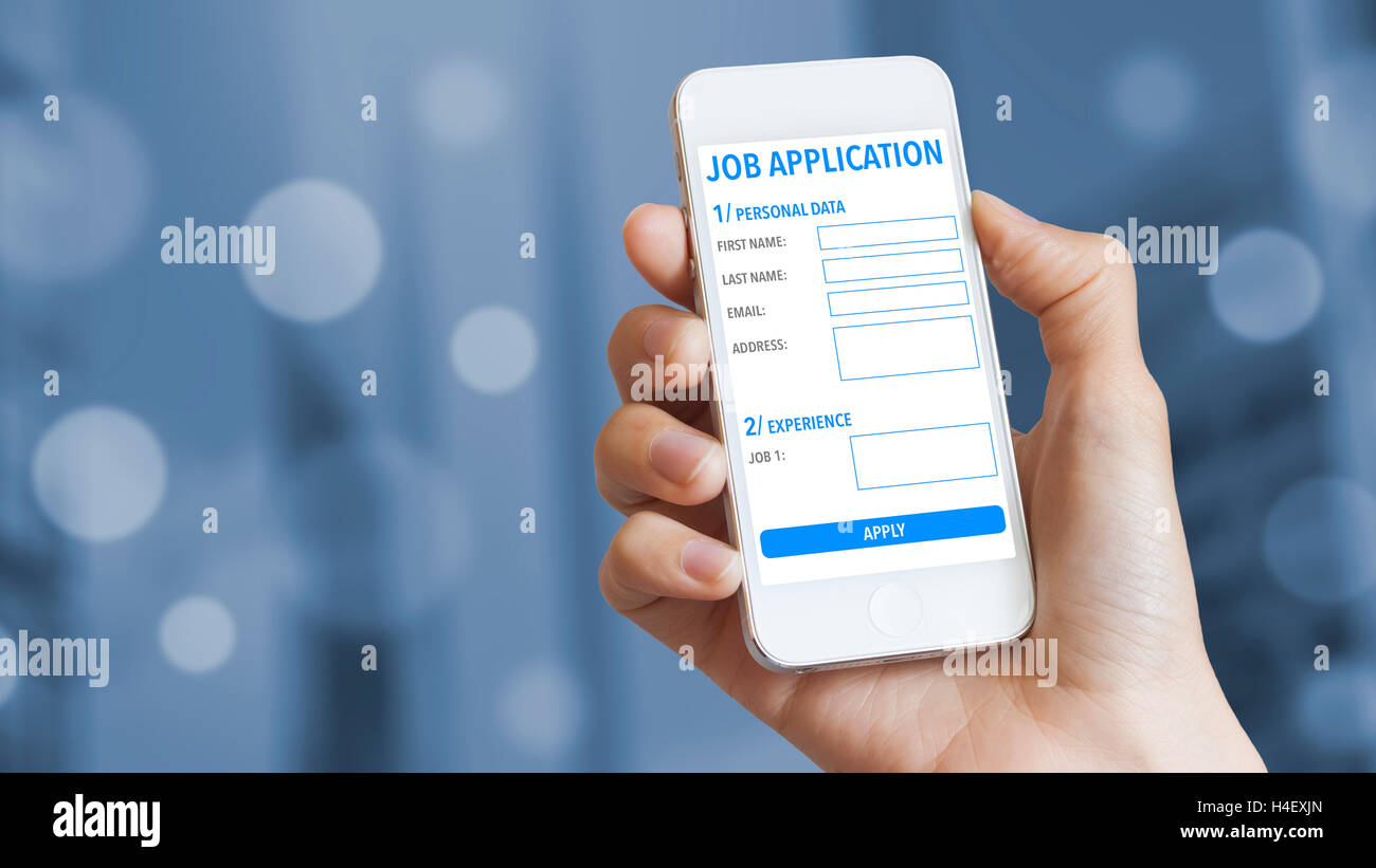 Online job application on mobile phone with business district in background - Stock Image
