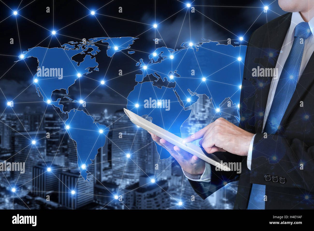 Double exposure of businessman using digital tablet connecting global business. Technology and network connection Stock Photo