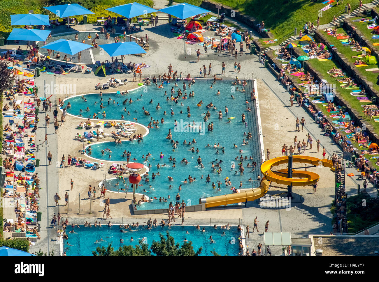 Aerial view, pool, swimmer pool with a wavy margin, lawn, Bathers in outdoor pool Annen, Witten, Ruhr district - Stock Image