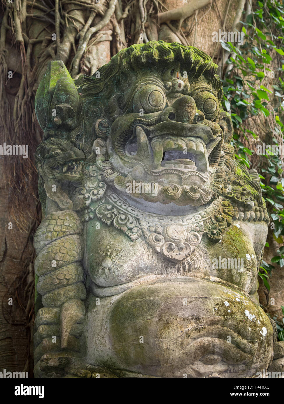 A typical old stone carving in the Ubud Monkey Forest in Bali, Indonesia. - Stock Image