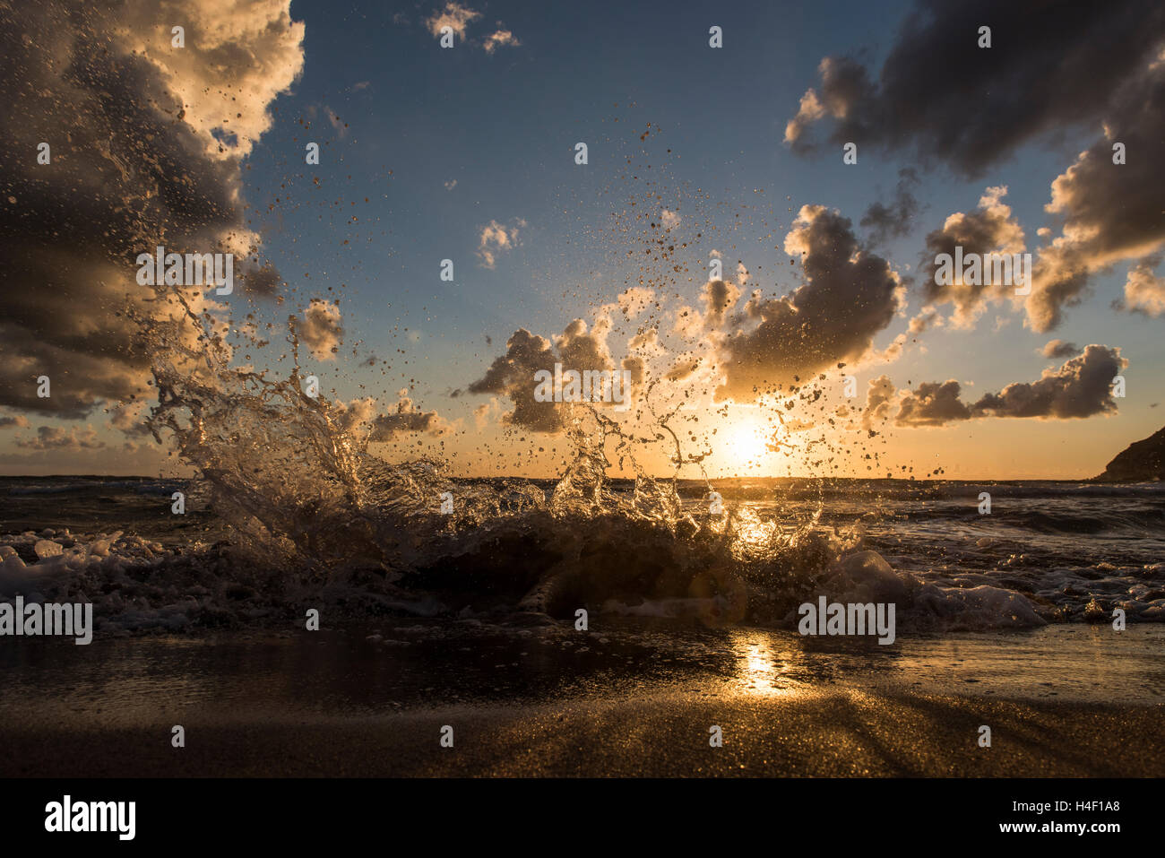 Crashing waves on the beach at sunset, Porto Ferro, Sardinia, Italy - Stock Image