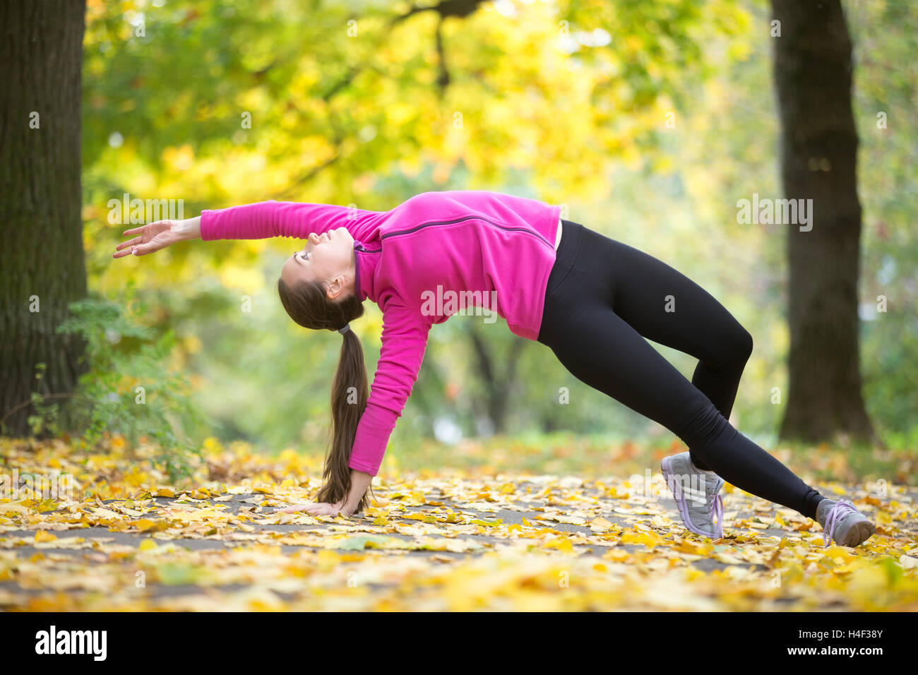 Autumn fitness: Wild Thing yoga pose - Stock Image
