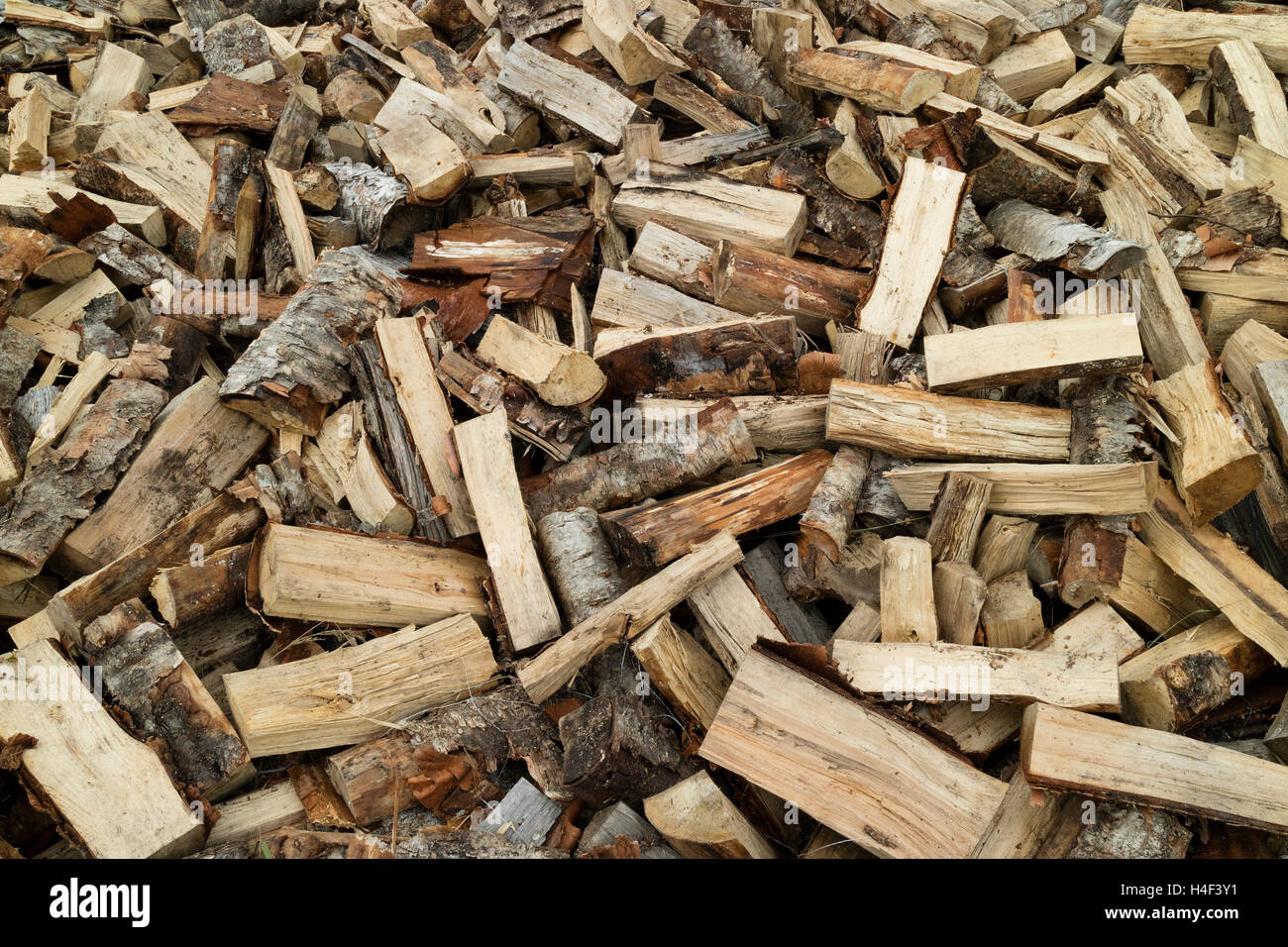 Firewood pile of wood cuttings for heating - Stock Image