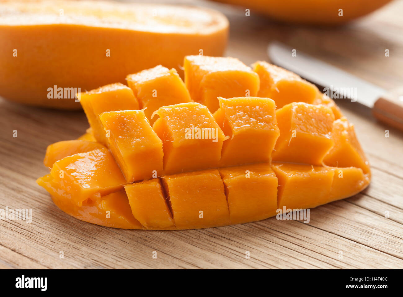 Fresh ripe juicy half yellow mango Stock Photo
