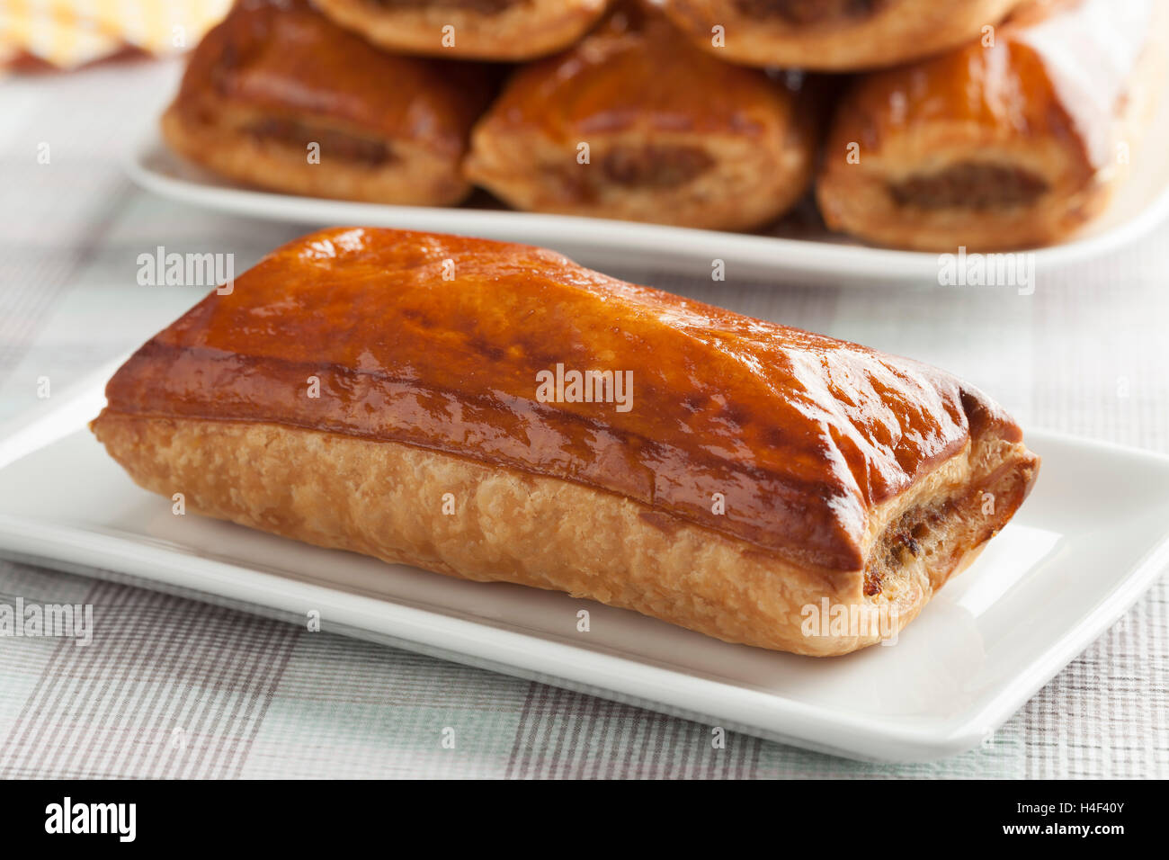 Fresh baked sausage roll, saucijzenbroodje, close up - Stock Image