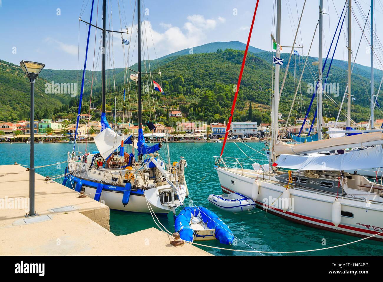 SAMI PORT, ITHAKA ISLAND, GREECE - SEP 21, 2014: yacht boats in port of Sami on Kefalonia island. Sailing is a popular - Stock Image
