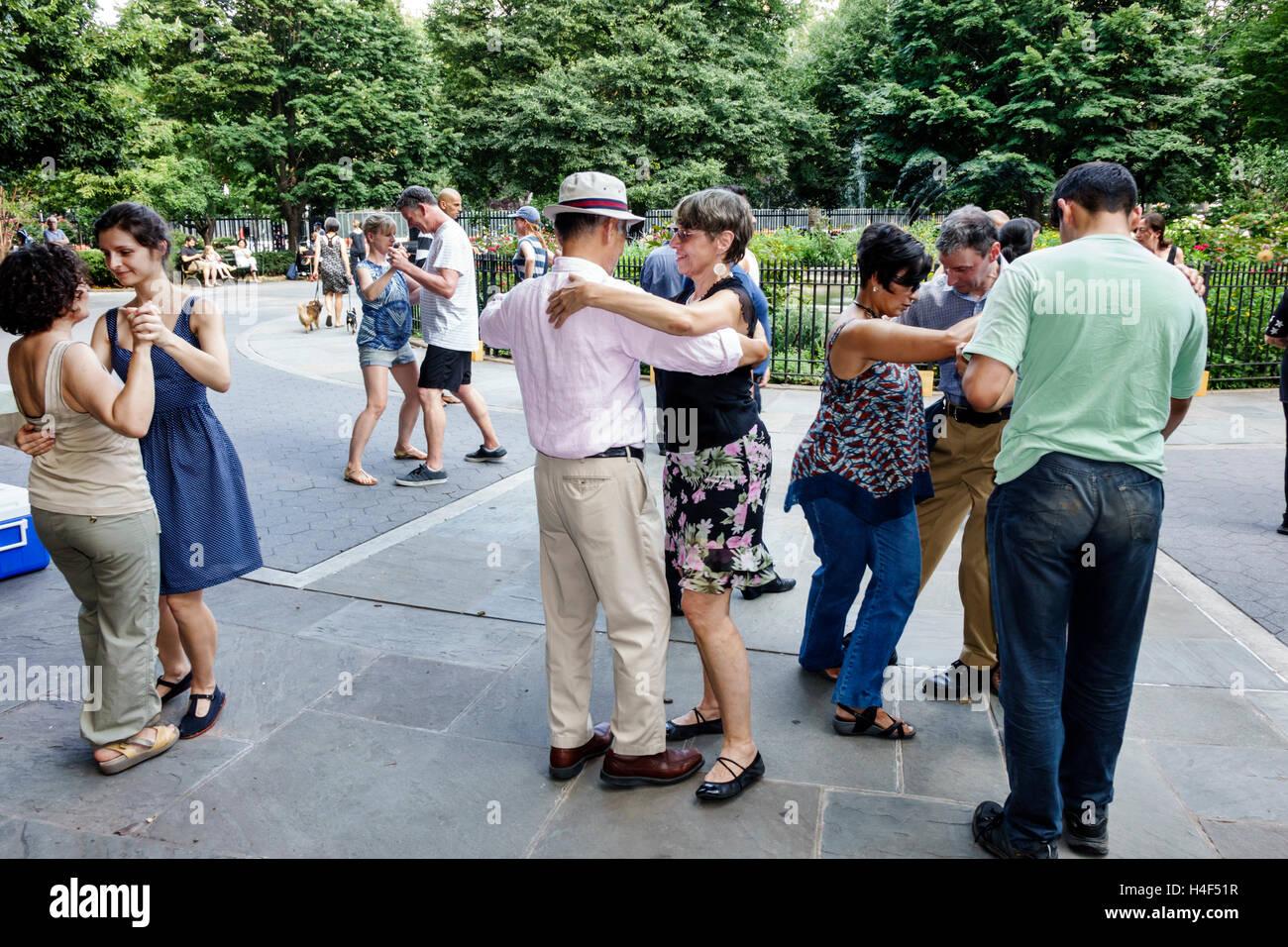 Manhattan New York City NYC NY Stuyvesant Square public park central fountain Tango Sundays with Esmeralda Argentine - Stock Image