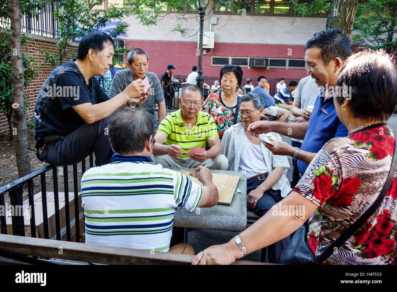 Manhattan New York City NYC NY Lower East Side Sara Delano Roosevelt Park neighborhood park Asian man mature leisure - Stock Image