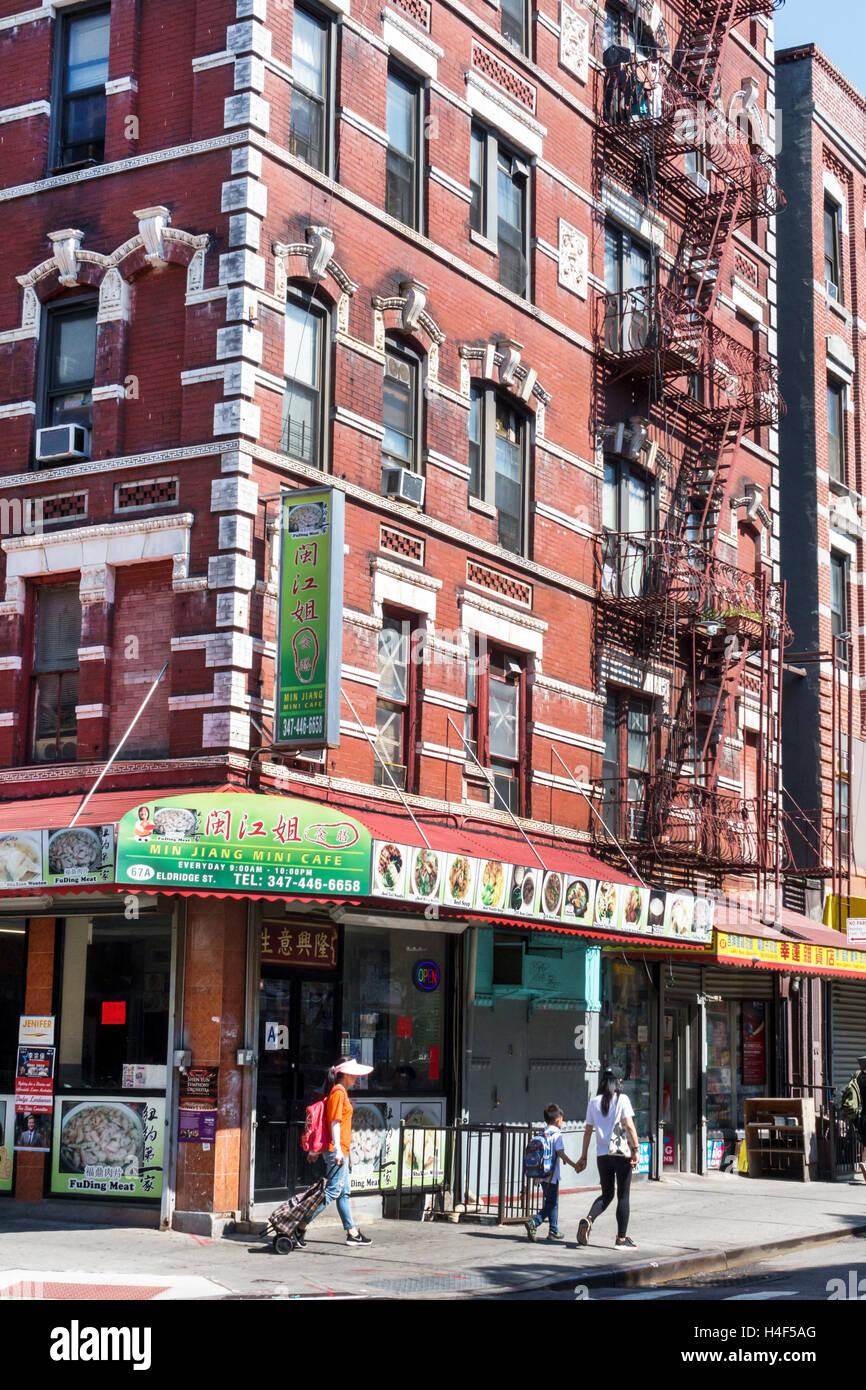 Lower Manhattan New York City NYC NY Chinatown Eldridge Street brick building fire escape business Min Jiang Mini - Stock Image