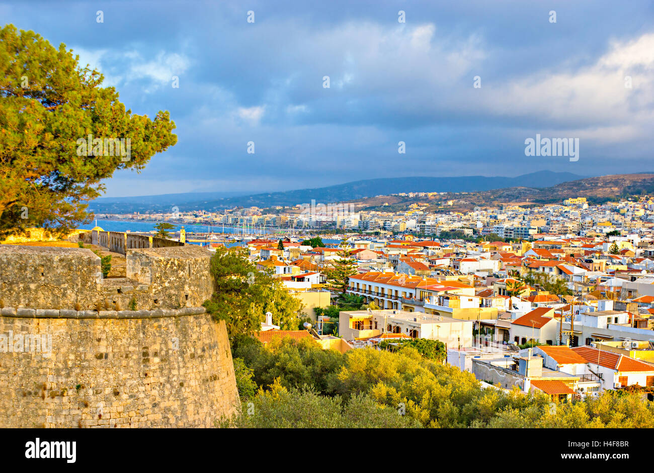 The view on Rethymno city and its port from the  Fortezza (Venetian citadel), located on the hill, Crete, Greece. Stock Photo