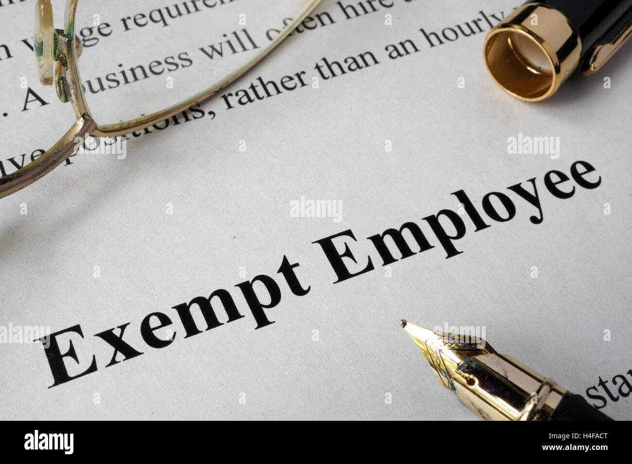 Exempt employee concept written on a paper. - Stock Image