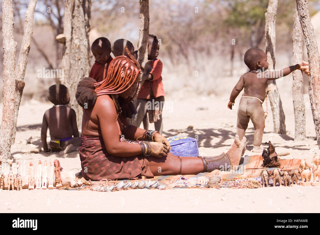 himba women with their children in a camp in north namibia - Stock Image