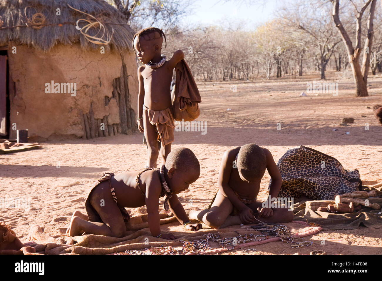 himba women and children in a camp in north of namibia - Stock Image