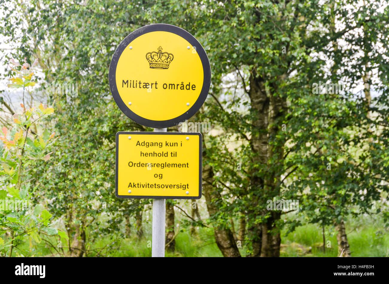 Military sign in Denmark reading Militært område - Stock Image