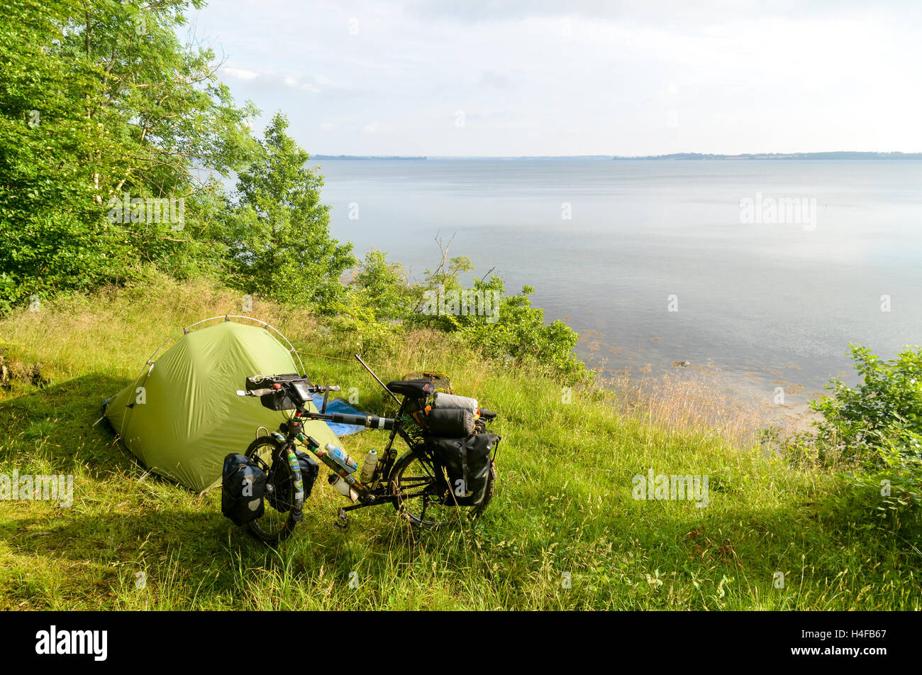 Bicycke and tent by the Flensborg fjord, Germany - Stock Image