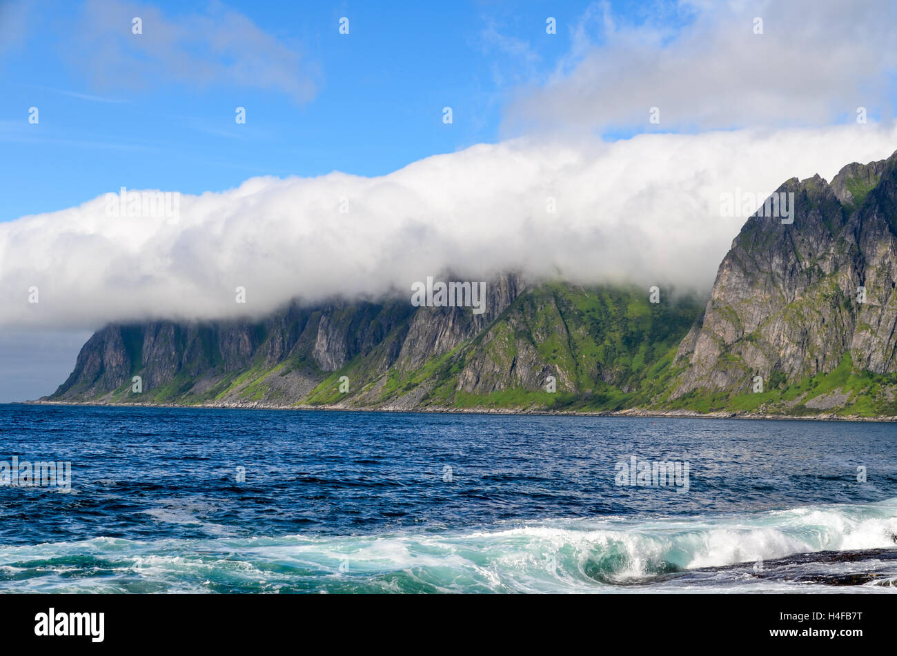 Clouds taking on the rough landscape of Senja, Norway - Stock Image