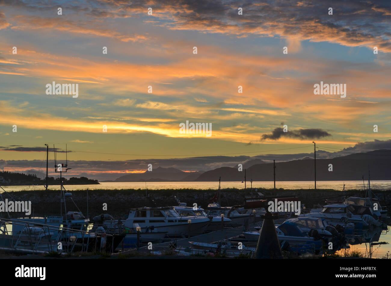 Sunset over the port of Botnhamn, Senja, Norway - Stock Image