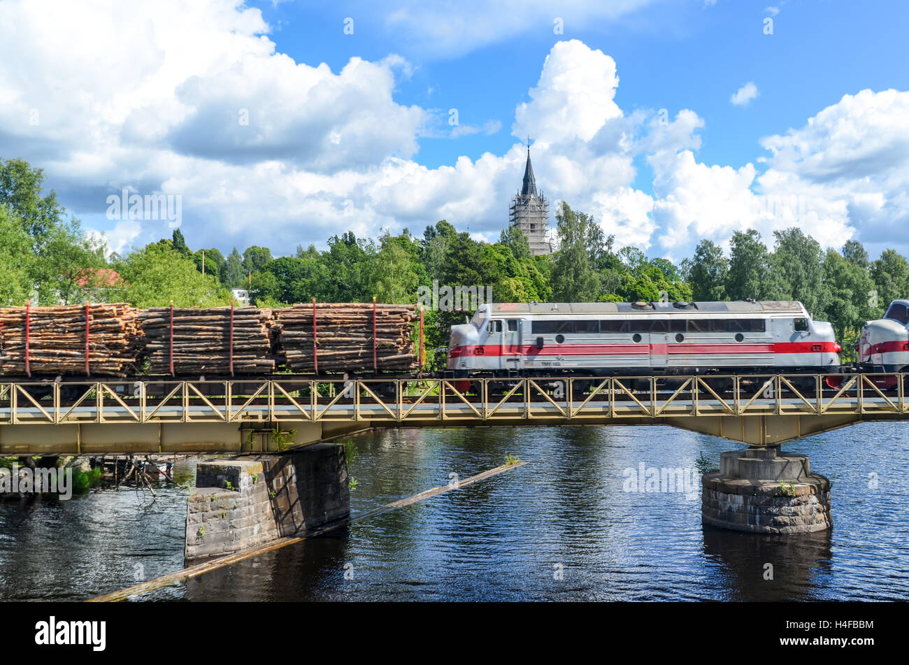 Train transporting wood logs in Sunne, Sweden. Wood is one of the main exports of Sweden - Stock Image