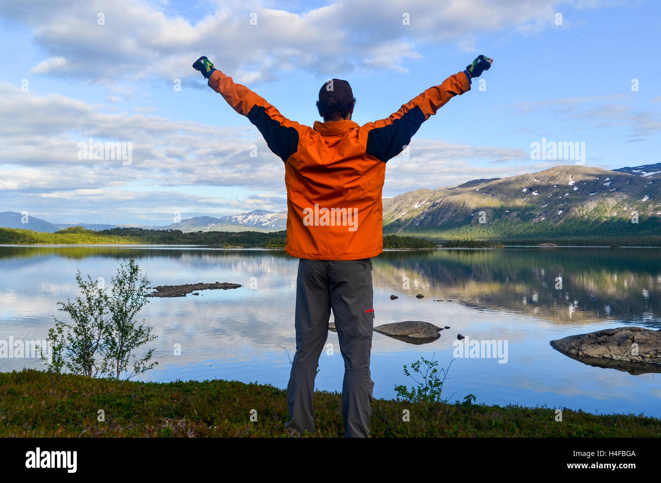 Man arms up in northern Sweden - Stock Image
