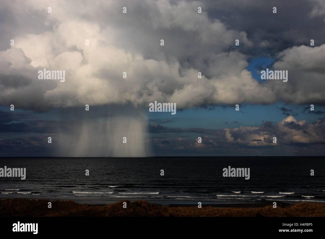 Mushroom shaped rain cloud near the sea shore - Stock Image