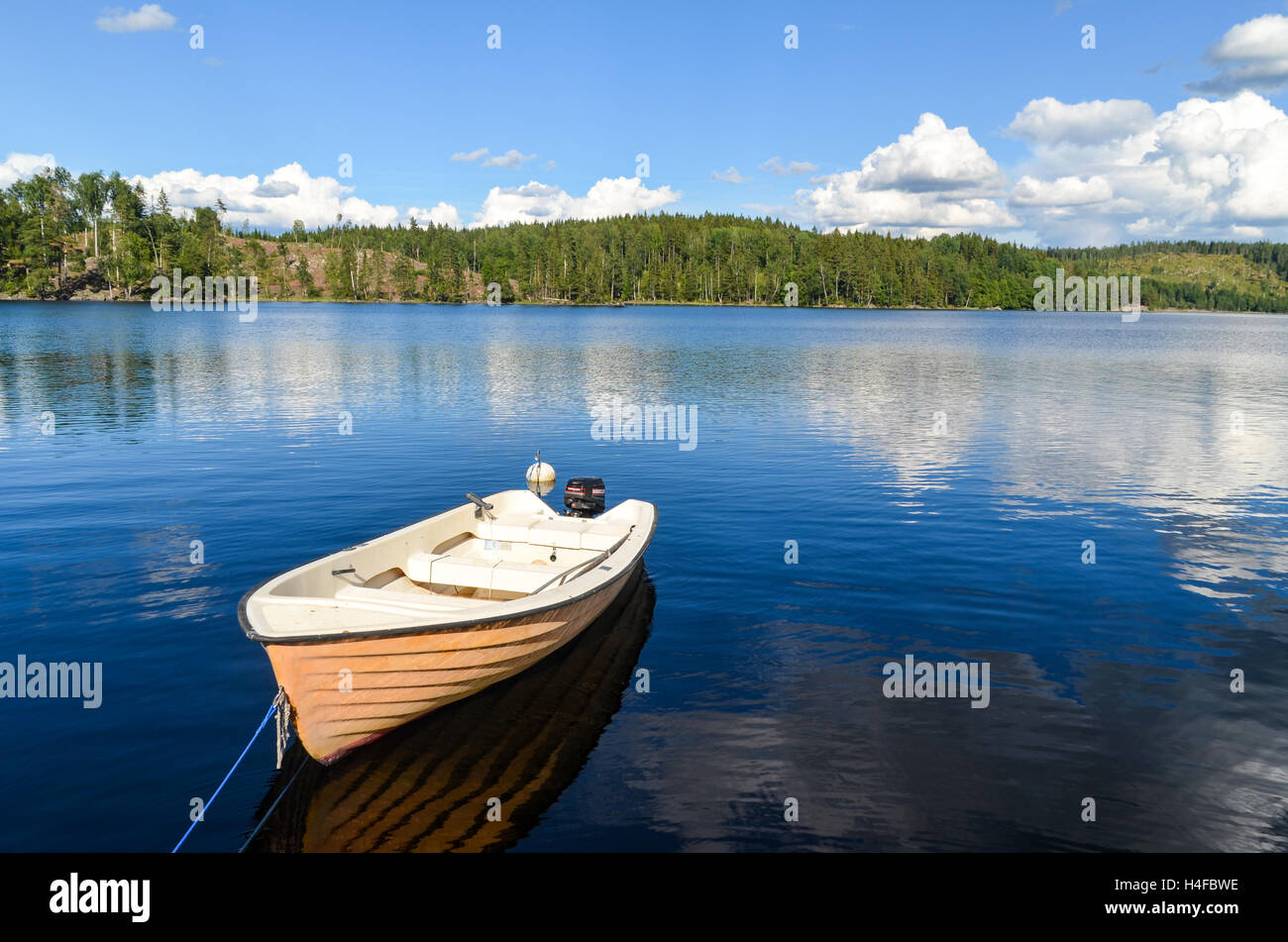Outdoors in Sweden: boat on a lake near Hedekas - Stock Image