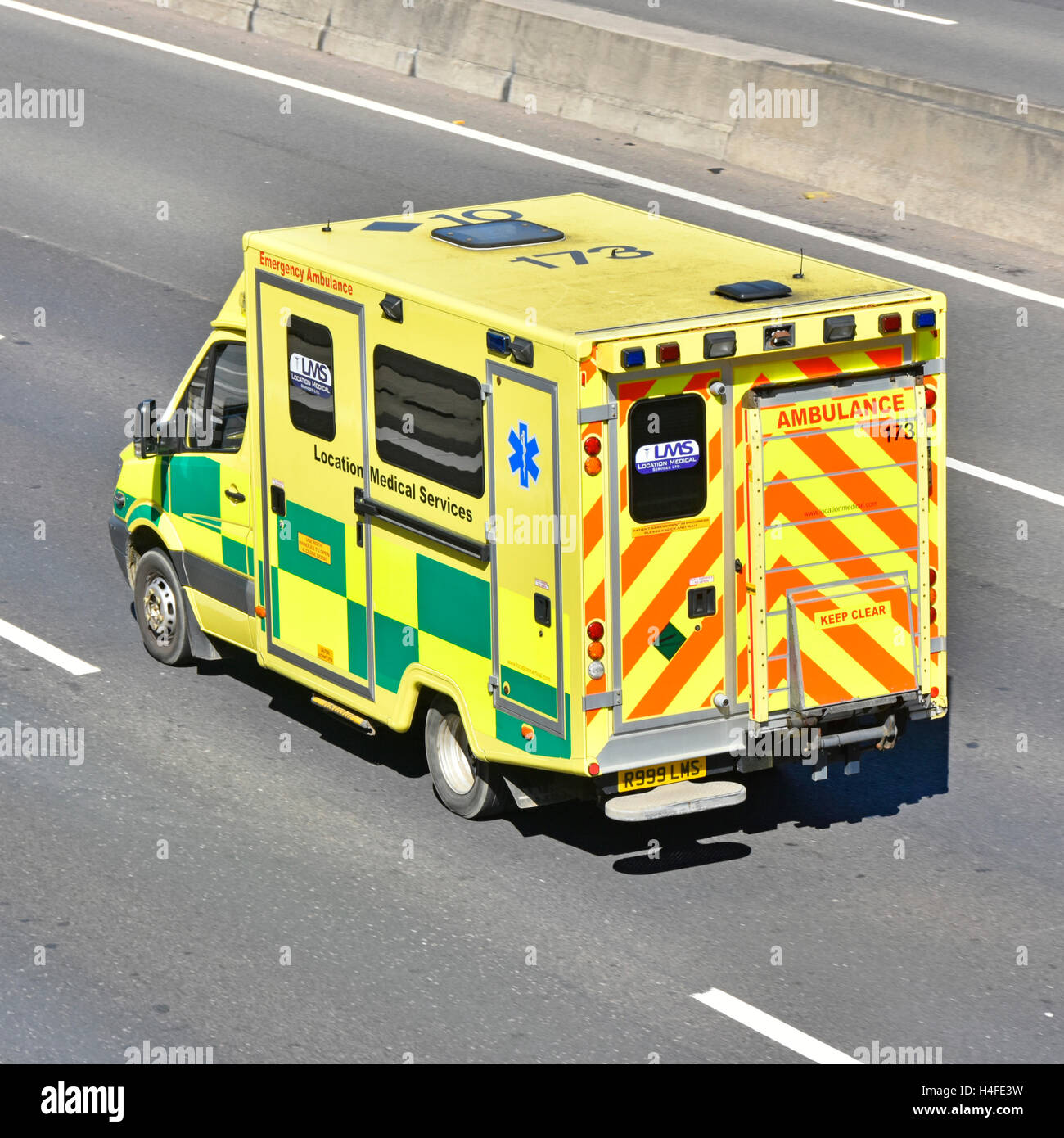 Back & side view private healthcare ambulance operated by Location Medical Services (LMS) patient health care - Stock Image