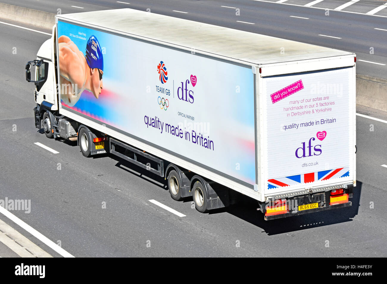 HGV Logistics Distribution Lorry Driving On UK Motorway With Articulated  Trailer Advertising Dfs Sofa Furniture Products U0026 Sponsorship Of Team GB